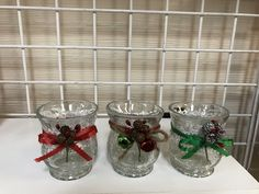 I took plain crackled glass votive holders, and made them festive for the holidays. This was made with snowflake ribbon, red or green ribbon, either gold or snow covered Pinecones with berries, and jingle bells. Glass Tea Light Holders, Glass Votive Holders, Diy Candle Holders, Diy Candles, Green Ribbon, Jingle Bells, Diy Christmas, Tea Lights, Snowflakes
