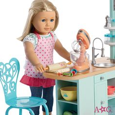 American Girl doll rolling dough with kitchen set