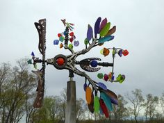 This kinetic wind sculpture by Seattle artist Andrew Carson was purchased in It's located at Matthaei Botanical Gardens near the Alexandra Hicks Herb Knot Garden and the perennial garden. Wind Sculptures, Ann Arbor, Botanical Gardens, Beautiful Gardens, Wind Chimes, Perennials, Seattle, Knot, Herbs