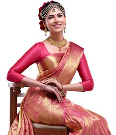 Silk sarees are indispensable to an Indian women's wardrobe. To match the grandiose of these sarees, one must carefully choose a designer blouse for an elevated look. Check out these gorgeous silk blouse designs to match different types of sarees. South Indian Blouse Designs, Silk Saree Blouse Designs, Saree Blouse Patterns, Designer Blouse Patterns, Indian Dresses, Indian Outfits, Sari Bluse, Indische Sarees, Indian Silk Sarees
