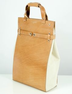 The 100% natural white cotton canvas tote with brown leather. The most knowledgeable costumer whose expert taste lies in exceptional materials and functionality will be delighted by it's vegetable tanning lined with suede.