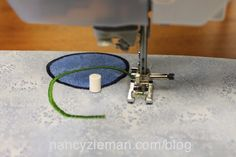 Use the versatile Circles Sew Simple Tool that easily attaches to the bed of the sewing machine with double-sided tape to stitch perfect circles.