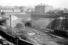 The large building in the centre is at the bottom of Woodborough Road, the old gas works, with Huntingdon Street going down to the right. The road in the foreground with the cars is York Street; the tunnel entrance is the north end of Victoria Station. Old Pictures, Old Photos, Nottingham Station, Castle Gate, European River Cruises, Old Train Station, Disused Stations, Local History, Family History
