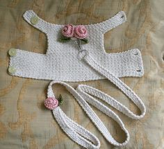 This dog harness has two beautiful handmade roses on its back .  The dog harness is made out of Cream cotton fabric. Care instruction: Machine wash