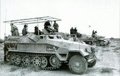 Sdkfz. 251/6 ausf. B with fieldmade anthenna and a large box stowed on the side.