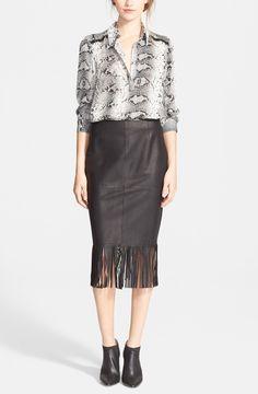 Lavish fringe lends bohemian swing to this svelte leather pencil skirt.