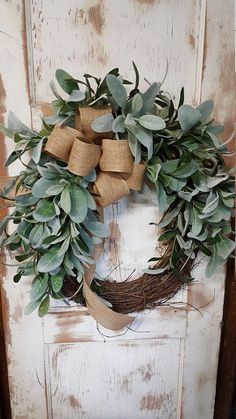 Handmade item Materials: grapevine wreath, glue, wire, wired burlap, realistic fern, realistic greenery Made to order Ships from United States Questions? Contact shop owner Item details This beautiful burlap front door lambs ear greenery wreath is the perfect simple accent for your door or interior. A wired burlap ribbon makes a simple bow. FRONT DOOR WREATH. The lambs ear looks and feel real. Love this wreath Average Diameter: 22 (tip to tip) This wreath will be created on a grapevine w...