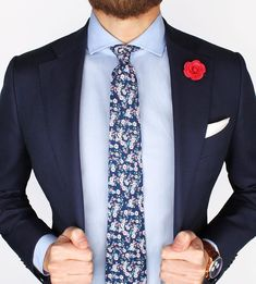 The new Admiral floral tie, Pink microfiber lapel pin and white silk ps over the Light blue poplin shirt  www.Grandfrank.com