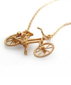 Vintage bicycle necklace by Alex Monroe. Love.