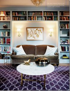 Love this built-in #bookcase surrounding the Lee Industries sofa. Design by Angie Hranowsky.