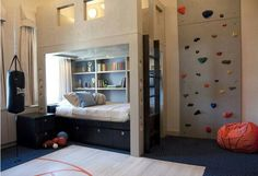 There's a BASKETBALL COURT in this room! Lets not forget to mention the ROCK CLIMBING WALL! And a PUNCHING BAG!