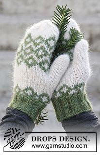 """Christmas Magic - DROPS Christmas: Knitted DROPS mittens with Nordic pattern in """"Air"""". - Free pattern by DROPS Design"""