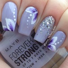 Light blue nails with flower petals polka dots and glitter