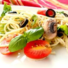 spaghetti is the pasta backbone of this light salad featuring lots of sweet grape tomatoes, black olives, and sliced fresh mushrooms in a dressing with a mediterranean vibe. it's perfect for a summer day. Antipasto Pasta Salads, Pasta Salad Recipes, Great Recipes, Favorite Recipes, Healthy Recipes, Healthy Menu, Recipe Ideas, Healthy Eating, Summer Pasta Salad