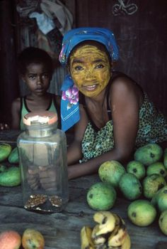 Africa | Madagascar. Island of Nosy Be. A woman wearing the yellow face powder that is a traditional body decoration. 1991.  | © Bruno Barbey.