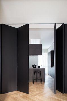 Black Box by Studio Tenca & Associati Modern apartment located in Italy, designed in 2017 by Studio Tenca & Associati. Movable Walls, Interior, Home, Folding Walls, Diy Sliding Door, Doors Interior, House Interior, Wood Doors Interior, Modern Apartment