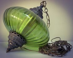 We had this lamp in the 70s.  It was a swag lamp and I was always afraid it was going to fall on someone and kill them!