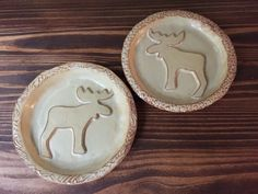 Moose Trinkets/Plates With a soft yellow glaze and brown distressed edges gives these plates a rustic look for the fall decor. 4 Elements Pottery