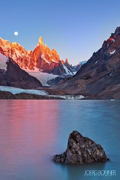 Cerro Torre with Full Moon at Sunrise by Joerg Bonner, via 500px; Southern Patagonian Ice Field in South America.#travel #budget #free