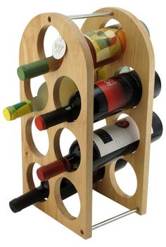 This wine rack design is relatively simple in comparison to some other rack designs. This rack uses wood for its main frame, and metal for is supporting poles. This rack can hold up to 7 bottles. Woodworking Workshop, Woodworking Projects, Diy Projects, Wine Rack Design, Wholesale Promotional Products, Wine Caddy, Wine House, Wood Wine Racks, Wine Storage