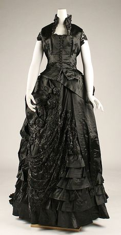Dinner Dress of Black Silk & Glass Bead Embroidery with Elegant Asymmetric Skirt Details. American or European, 1870s.