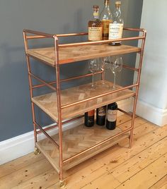 3 tier drink trolley in a retro industrial style with polished copper frame and reclaimed oak herribone panels Getränkewagen im Retro-Industriestil mit polierter Oberfläche Copper Furniture, Pipe Furniture, Recycled Furniture, Vintage Furniture, Industrial Furniture, Retro Industrial, Industrial Lamps, Drinks Trolley, Copper Frame