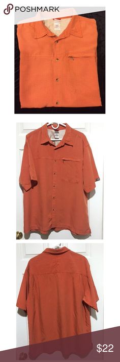 """Mens North Face Checked Button Shirt Zip Pocket XL The North Face, Men's short sleeve, button front shirt in size XL.  Orange checked pattern with zippered front pocket.  Mesh lining in neck area. Excellent per-owned condition with no tears, rips, stains or odors. 93% Modal 7% polyester. Modal fabric is a great hiking/travel shirt as it's quick drying and wrinkle free. From a smoke-free home.  Measurements: 25"""" underarm to underarm 31"""" shoulder to hem 17"""" sleeve The North Face Shirts Casual…"""