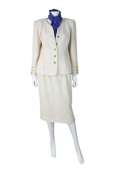 """This suit is the perfect example of why Chanel suits are so adored. In a soft cream the texture is woven wool resulting in the much coveted waffle style. Jacket Shoulder 17""""   Sleeve 22""""   Bust 19""""   Waist 17""""   Full Length 24"""".   eBay!"""