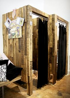 Tranquil Space Yoga Studio. retail space dressing rooms made of deconstructed wood pallets.