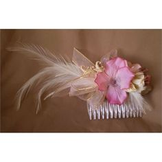 Victorian Style Wedding Floral Feather Bridal Comb Offering:   Feminine delicate pink hydrangea blossom surrounded by cream antiqued white and brushed gold leaf and feather accent buttons, nestled upon a cream rose bud and a sheer pink gold edged ribbon. Soft white dove feathers wisp from the center of this dainty hairpiece. Resting on a clear plastic toothed comb.   6 inches long roughly including feather  3 inches wide   Costume Accessories and Finery:  Twilight Faerie offers handcrafted…