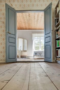 Wooden floors and blue doors. Farm in Gotland, Sweden