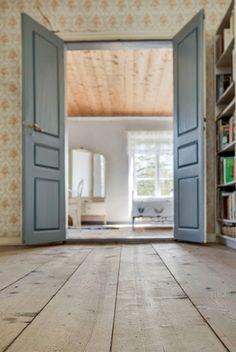 Wooden floors and blue doors. Farm in Gotland, Sweden