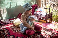 uyghur mother and baby in their home in Kashgar in the remote xinjiang Province, in far western china on the border with pakistan.
