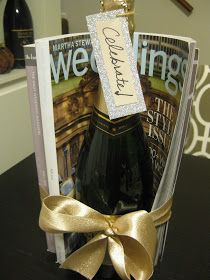 Engagement Gift, a bottle of champaign with magazines wrapped with a ribbon