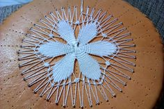 El encaje de Tenerife es un encaje de aguja considerado uno de los posibles orígenes del Ñanduti y de los soles de Maracaibo.      Los s...
