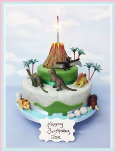 All included, a beautiful two tier party cake with keepsake toy dinosaurs and volcano with sparkler eruption. The cake comes in a choice of delicious fillings with a 6 inch round top tier cake and 10 inch round base. All of our cakes are made fresh to ord Dinosaur Birthday Cakes, 4th Birthday Cakes, Dinosaur Party, Birthday Ideas, Dinasour Cake, Festa Jurassic Park, Volcano Cake, Dino Cake, T Rex Cake