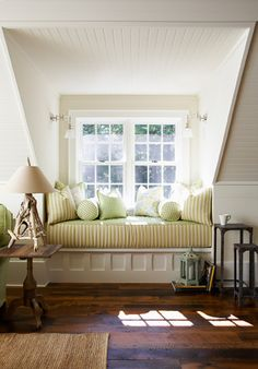 A cozy window bench rests beside a light-filled dormer window, perfect to read on a stormy night!!!