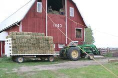 Storing bales in the hay mow. I liked to unload and put them on the elevator.  Cooler than up in the hay mow stacking.