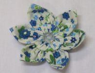Como fazer uma flor de tecido usando fuxico