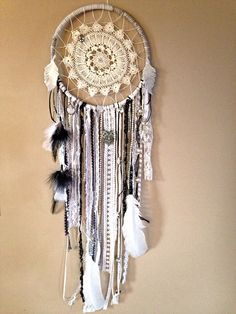 DIY bohemian gypsy dream catcher with vintage crochet doily, leather, lace, and feathers