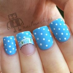 This is a very pretty blue polka dot nail art design. Have adorable nails with this light blue polka dot nail art design with a floral French tip detail.