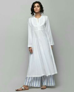 Tisya Plain Kurta from Women collection at Nicobar. Nicobar is for modern consumers who seek connection with things they acquire. Kurta Designs Women, Blouse Designs, Indian Attire, Indian Wear, Indian Dresses, Indian Outfits, Modest Fashion, Fashion Outfits, Kurta Patterns
