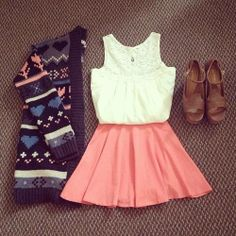 pink skirt. white shirt. patterned cardigan. brown wedge heels.
