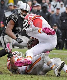 Kansas City Chiefs outside linebacker Tamba Hali picks up a Oakland Raiders quarterback Derek Carr fumble in the fourth quarter during Sunday's football game on October 16, 2016 at O.co Coliseum in Oakland, California.