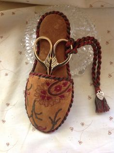 Hand stitched mini slipper to hold scissors.  by TheOldNeedleShop