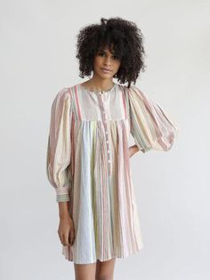 THE CASEY DRESS BY Antik Batik in striped cotton crepe. Airy cut and puffed sleeves. wrist length sleeves. Button tab on the bust. Material- 100% COTTON Color- multi stripe Designed in Paris - Made in
