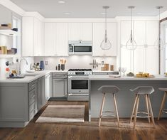 Hollings Maple Snowflake and Iron Grey. The on-trend white and gray color scheme and the simplistic styling of this kitchen create a sleek look that matches today's modern lifestyle. Thomasville Kitchen Cabinets, Kitchen Cabinets Reviews, Kitchen Cabinets Home Depot, Custom Kitchen Cabinets, Kitchen Remodel, Kitchen Reno, Farmhouse Cabinets, Condo Remodel, Grey Cabinets