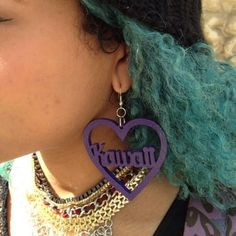 Emily wearing glitter purple acrylic perspex laser cut heart word earrings