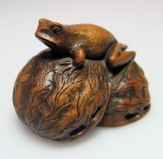 19th century Japanese wood nesuke of a frog. From K Antiques at Grays