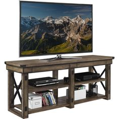 Features:  -Elegant light brown woodgrain with grey undertones finish with black metal accents means you'll be entertaining in style.  -Includes open shelves for easy access to components and accessor
